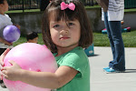 LePort Montessori Preschool Toddler Program Irvine San Marino girl holding a ball in the playground