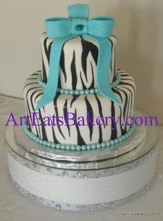 Two tier hand painted black and white zebra striped creative unique girl's birthday cake with Tiffany blue bow and edible pearls