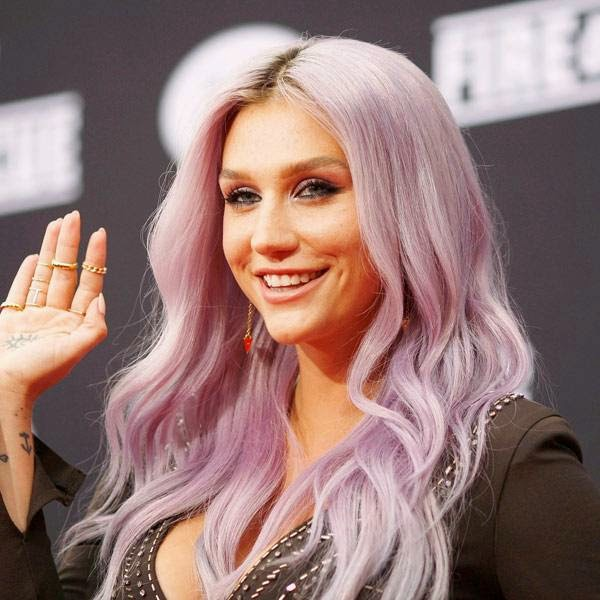 Kesha arrives at the premiere of Disney's Planes: Fire & Rescue sponsored by Coco Joy Kids at El Capitan on Tuesday, July 15, 2014, in Los Angeles.