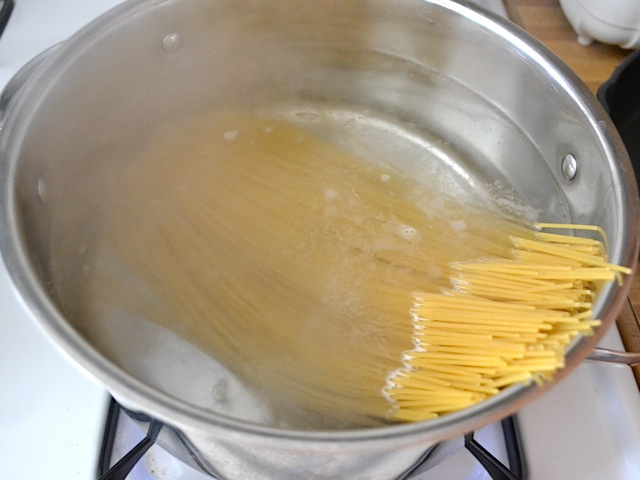 pasta cooking in pot of boiling water