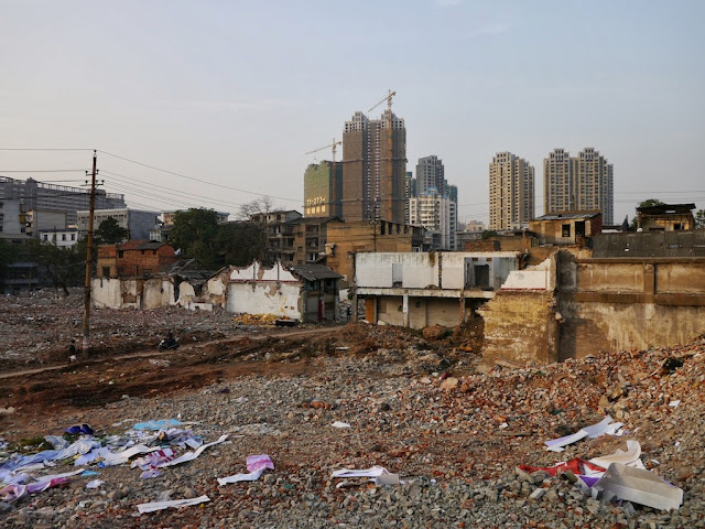 a view from a small hill of Beizheng Street with tall buildings being built in the background