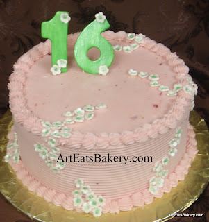 Sweet Sixteen strawberry cake with green 16 topper and edible flowers