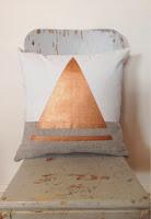 almohadones con dibujos en cobre