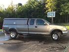 2002 Ford F-150 XL work truck with custom contractor cap