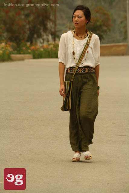 Loose top, flared gauze pant,wedge heels and a wooden necklace.