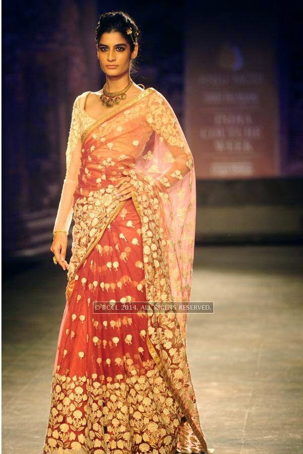 Erika walks the ramp for Anju Modi on Day 2 of India Couture Week, 2014, held at Taj Palace hotel, New Delhi.