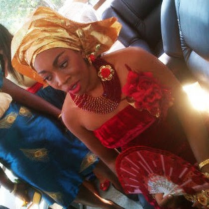 golden gele, coral beads