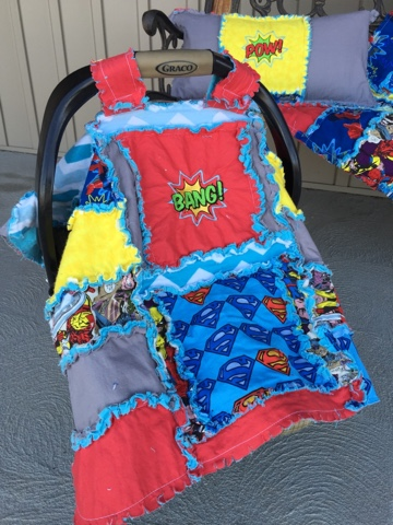 Superhero themed rag quilt car seat tent with superman, spiderman, hulk, and batman