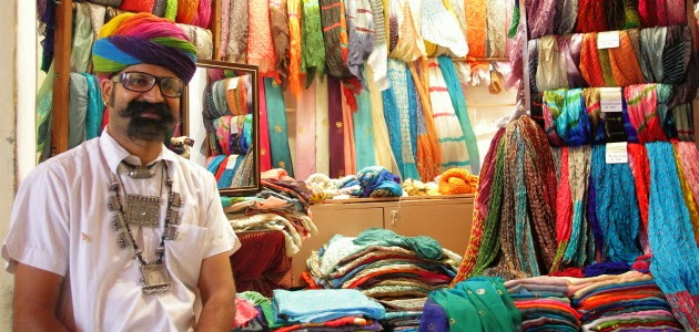 Rajsthani man with big moustache in front of his silk scarf shop at Jodhpur