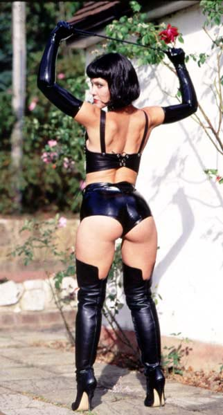 latex mistress in thigh high boots and  shoulder length gloves