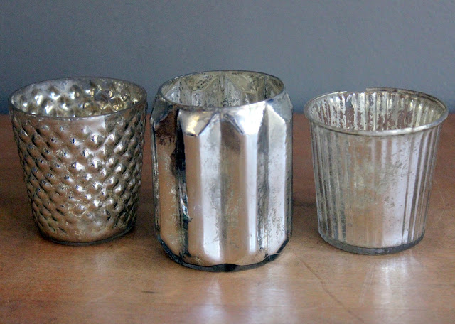 Mercury glass votives available for rent from www.momentarilyyours.com, $1.