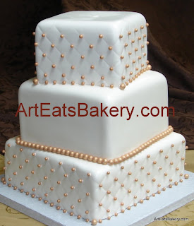 Three tier square fondant off set quilt and gold pearl custom wedding cake design picture