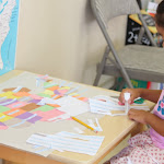 This is a big work! This five-year-old Montessori preschooler punched out all the US states, and assembled them into her very own map. She's now adding state names, which she wrote, to each state. Do you think she'll remember?!
