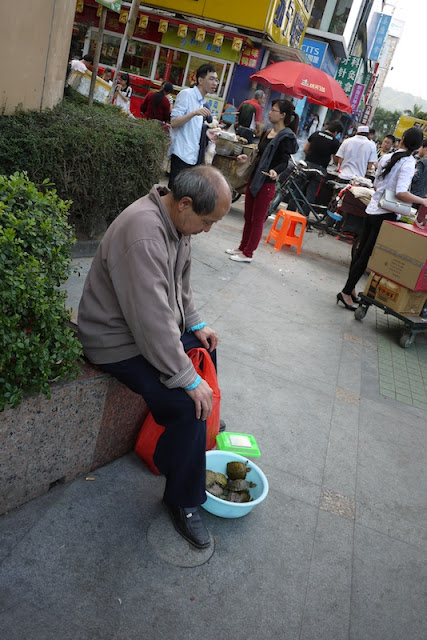 man selling turtles in Zhuhai, Guangdong