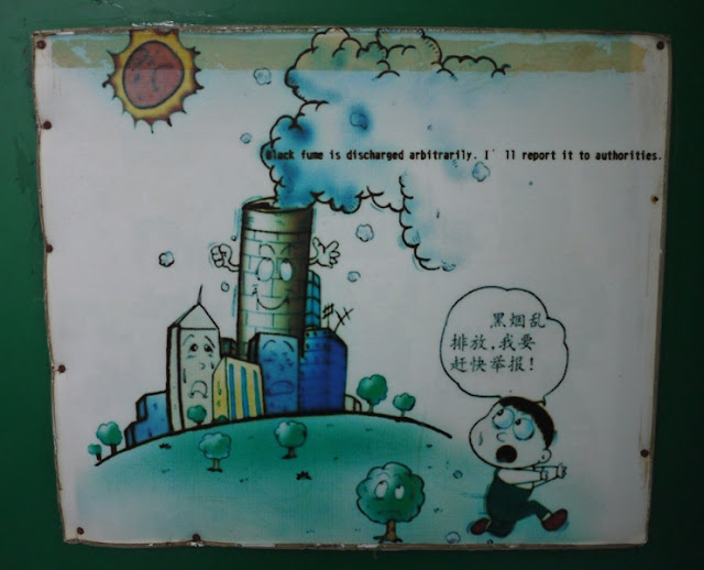 poster of kid running from polluting factory