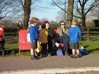 children at red metal bench in park