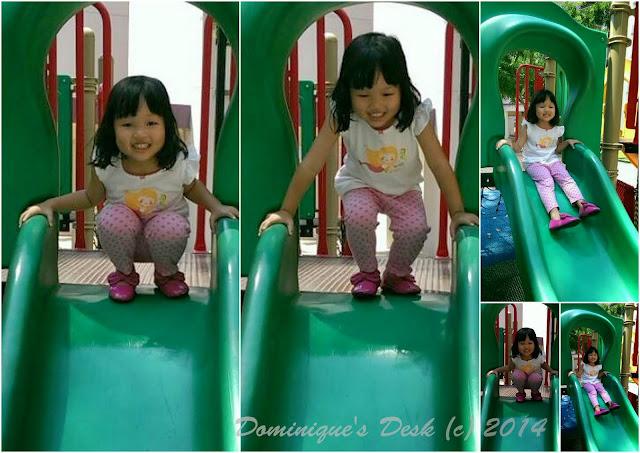 Tiger girl having fun on the slide