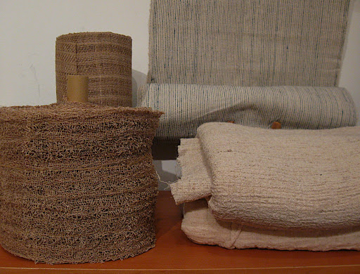bolts of handwoven fabric (the striped one is mine)