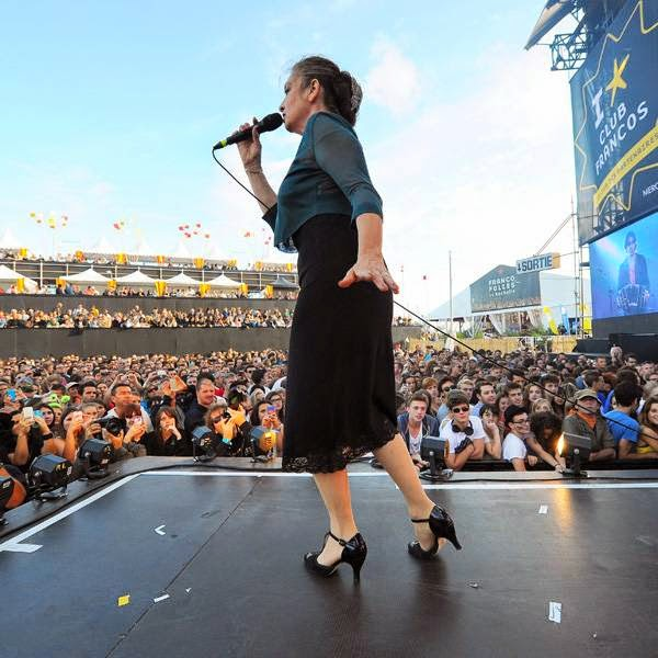 French singer Catherine Ringer performs on stage during a concert in La Rochelle on July 12, 2014 at the Francofolies festival.
