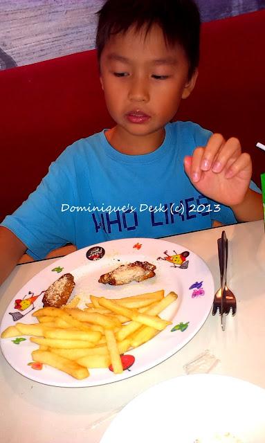 Monkey boy enjoying his food at Pizza Hut