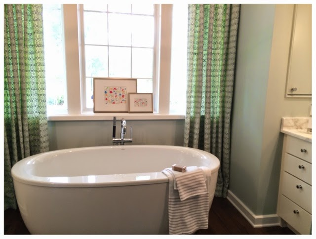 Big soaker tub.  2014 Southern Living Idea House in Palmetto Bluff, SC | The Lowcountry Lady