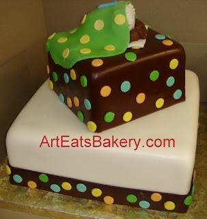 Two tier square brown, green, blue, yellow and orange polka dot fondant