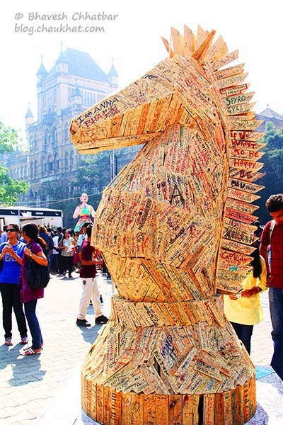 Kala Ghoda - Knight made of wooden scrap with hand-written messages by public