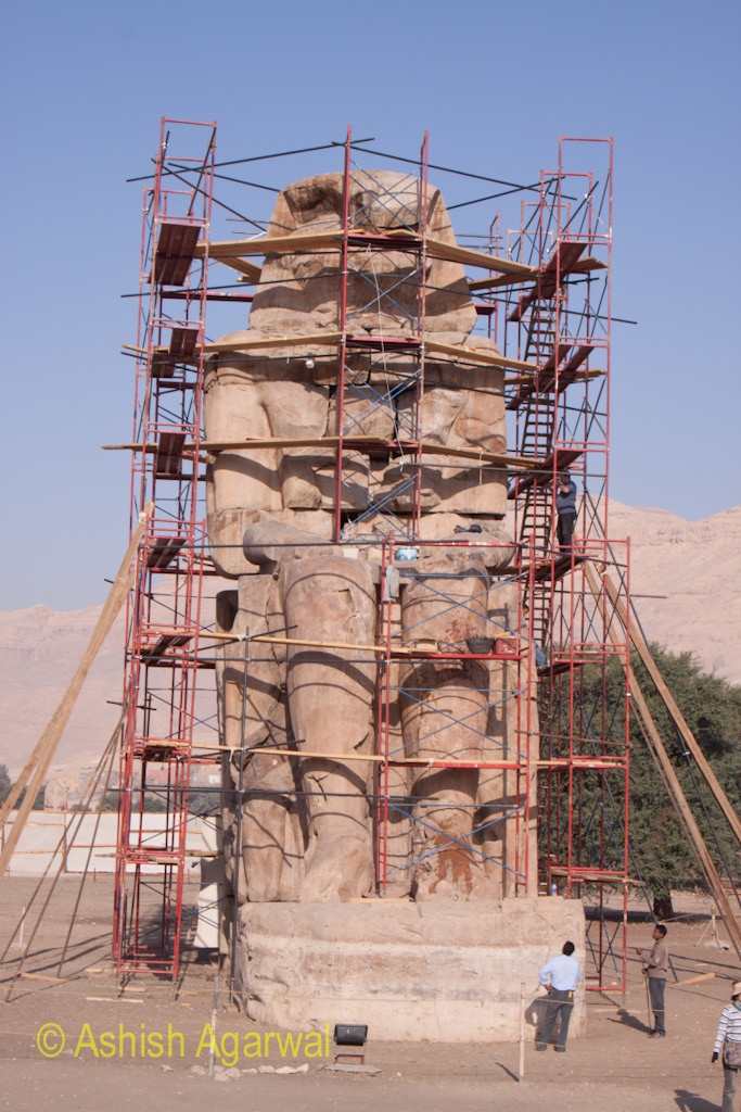 Portrait view of one of the statues of the Colossi of Memnon, covered with scaffolding