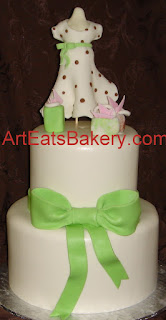 Two tier custom fondant baby shower cake with green bow, shopping bags, expecting mom maniquin with polka dot dress