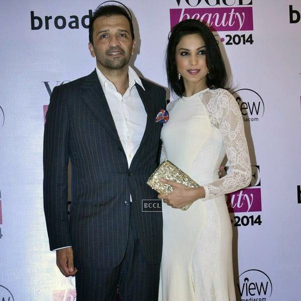 Atul Kasbekar poses with a guest during Vogue Beauty Awards 2014, held at Hotel Taj Lands End in Mumbai, on July 22, 2014.(Pic: Viral Bhayani)