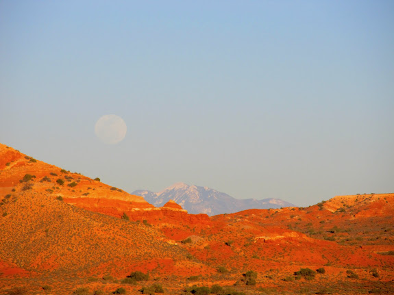 Moonrise over the La Sals at sunset