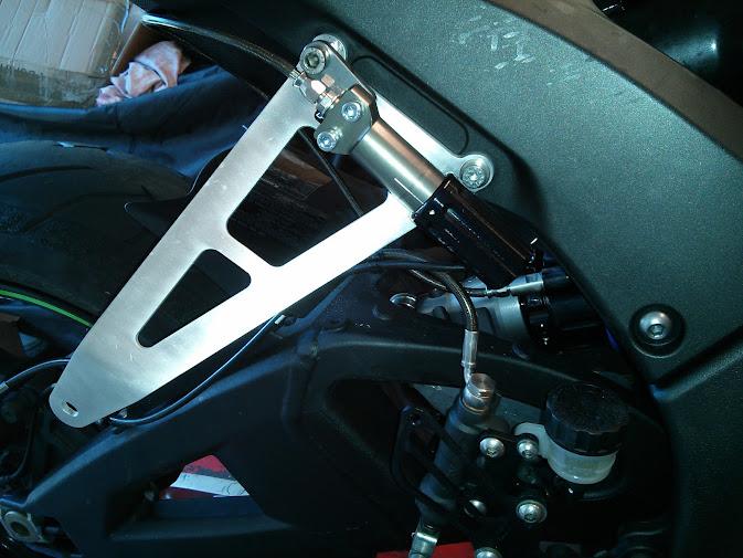 Exhaust hanger & remote preload adjuster