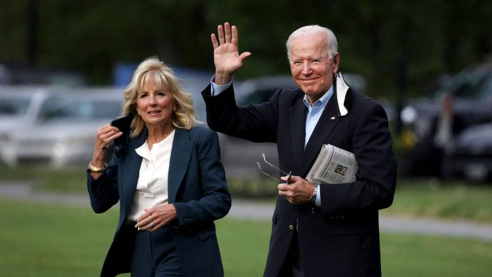 WASHINGTON, DC - JUNE 09: U.S. President Joe Biden waves as he and First Lady Jill Biden walk on the ellipse to board Marine One on June 09, 2021 in Washington, DC. President Joe Biden and the First Lady are traveling to the United Kingdom for the G7 Summit and will later travel to Belgium and Switzerland, as part of an eight day trip through Europe. (Photo by Anna Moneymaker/Getty Images)