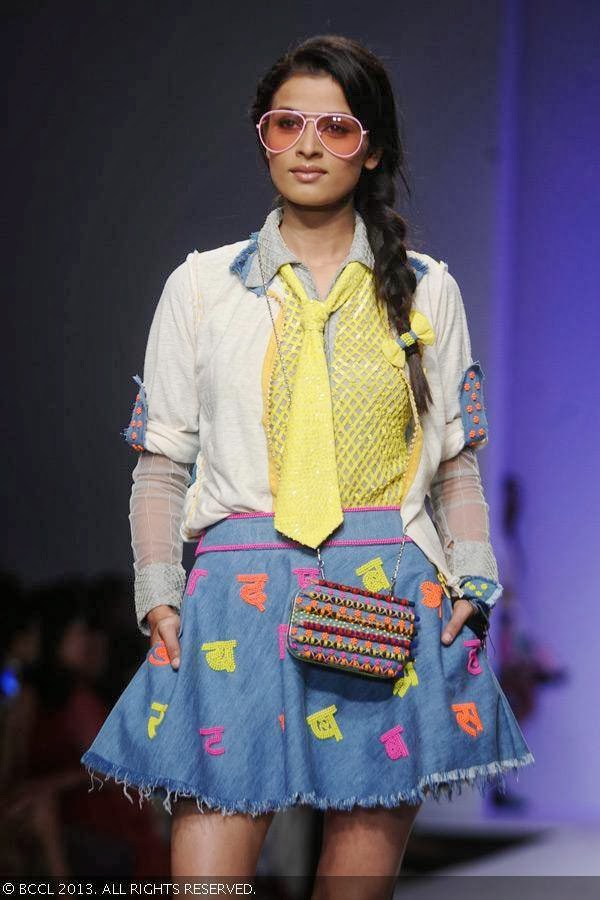 A model showcases a creation by fashion designer Niharika Pandey on Day 4 of Wills Lifestyle India Fashion Week (WIFW) Spring/Summer 2014, held in Delhi.