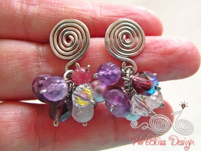 Wire wrapped Cluster earrings with mixture of purple or near purple gemstones and crystals