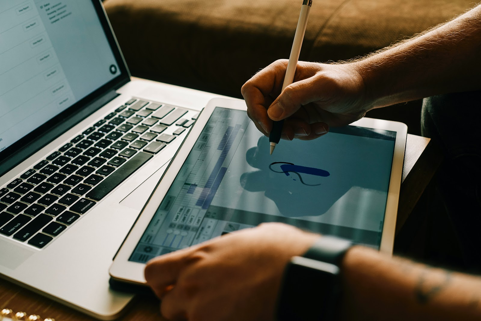 a man animating on a drawing tablet