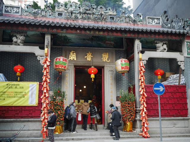 people entering Kwun Yum Temple in Hong Hom, Hong Kong
