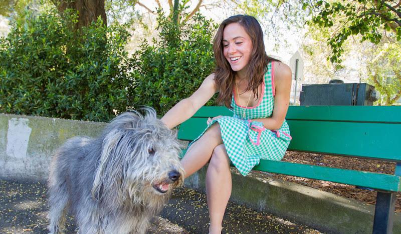 Seersuckered Shelley pets a shaggy dog