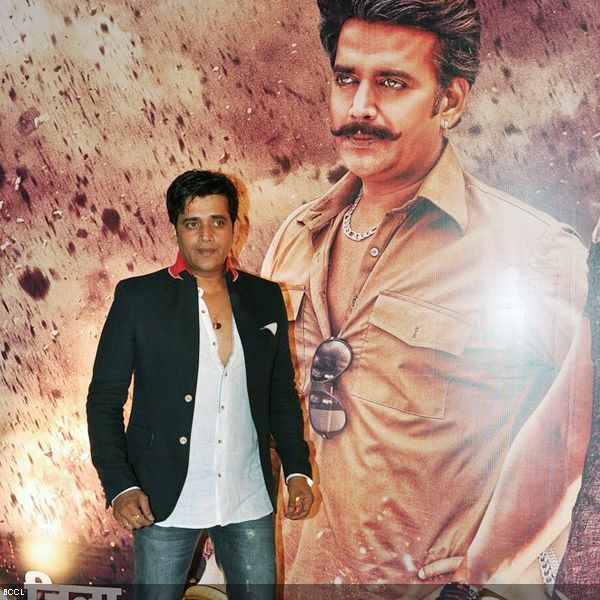 Ravi Kishan proudly poses next to his poster at the premiere of the movie 'Zila Ghaziabad', held at PVR Cinema in Mumbai, on February 21, 2013. (Pic: Viral Bhayani)