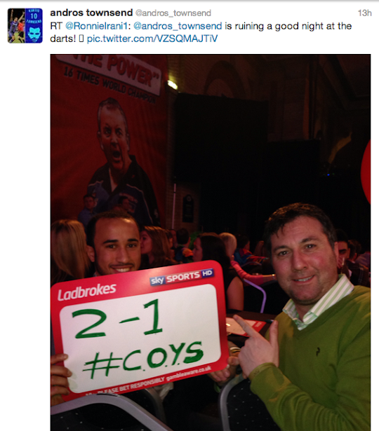 Andros Townsend celebrates Tottenhams win at Old Trafford with banner at the darts