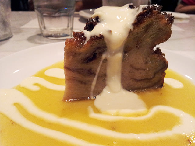 Bread and butter pudding with whiskey and custard sauce