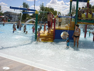 pic of our local aquatic center with colorful play equipment