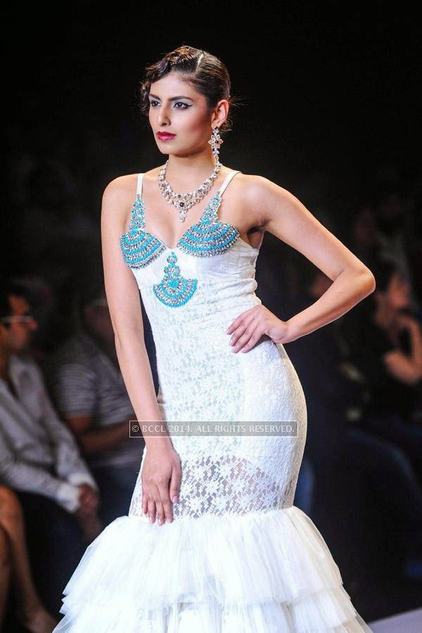 A model displays a creation for Gitanjali on Day 2 of India International Jewellery Week (IIJW), 2014, held at Grand Hyatt, in Mumbai.<br /> <br />