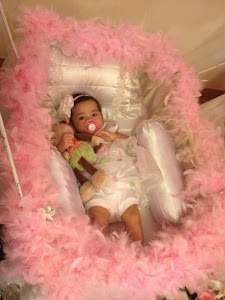 Qarla all cozy in her cradle