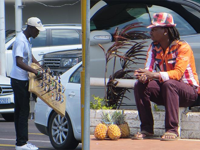 straatverkopers met zonnebrillen en ananassen,  bij stoplichten Durban, Zuid Afrika
