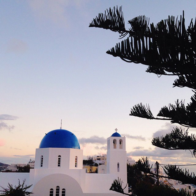 Blue domed church in Santorini Greece.