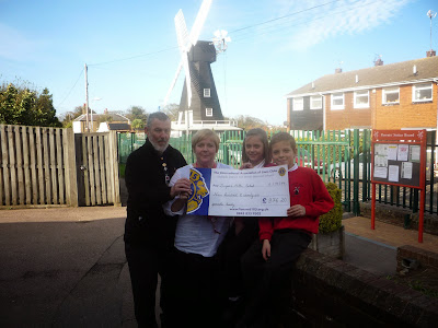 Cheque to Draper Mill School