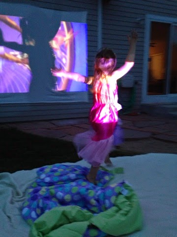 Summer movie night in the back yard! Fun for kids and romantic for date nights! Easy set up projectors are on sale everywhere for the summer! www.thebrighterwriter.blogspot.com