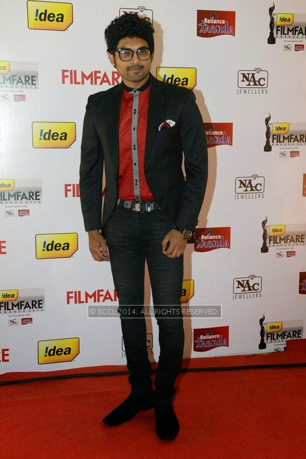 Actor Ajmal Ameer dons a geeky look at the red carpet for the 61st Idea Filmfare Awards South, held at Jawaharlal Nehru Stadium in Chennai, on July 12, 2014.