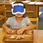 Montessori private school girl refining fine motor schools through sensorial development.